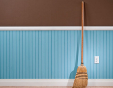 broom leaning against wall