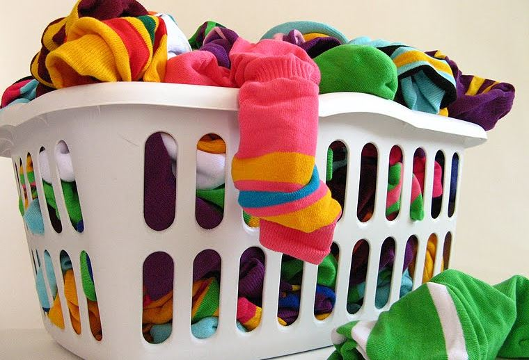 laundry basket full of colorful clothes