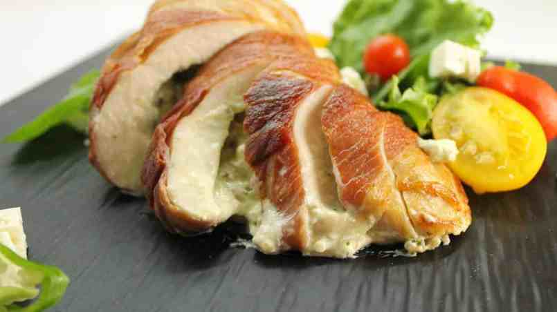 A savory stuffed chicken breast wrapped in Prosciutto bacon. Learn how to properly stuff chicken!