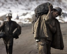 Miners lumping coal to their homes after a shift in a mine in Shanxi province. (Photo: AAP)