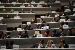 Delegates attend the opening of a World Trade Organization ministerial conference on December 15, 2011 in Geneva. (Photo: AAP)