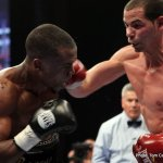 Photos: Abril Retains WBA Title, Russell Wins