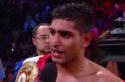 Khan signs for Mayweather fight but is also willing to face Pacquiao   which match up is most appealing?