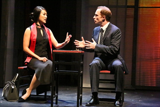 "Xi Yan, Vice Minister of Culture, played by Kara Wang, explains a situation to American businessman Daniel Cavanaugh, played by Matthew Jaeger in East West Players production of David Henry Hwang's ""Chinglish."" Photo by Michael Lamont."