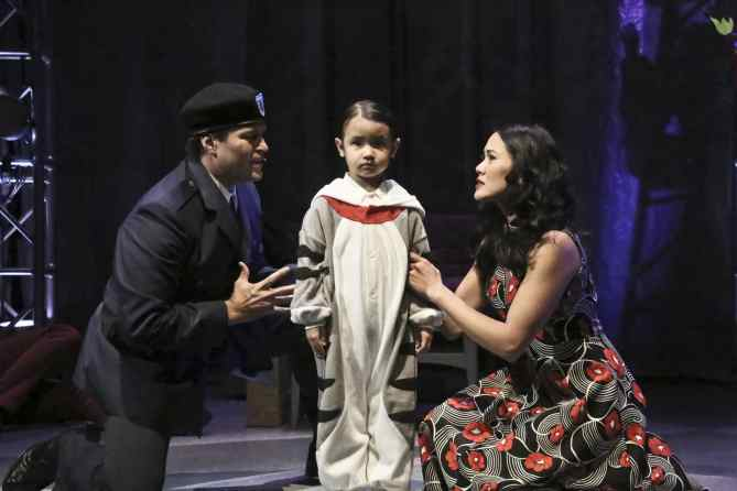 "Captain Walker (Cliffton Hall) and Mrs. Walker (Deedee Magno Hall) try to convince 4 year-old Tommy (Araceli Prasarttongosoth) that he did not see or hear the murder that just took place in the East West Players production of ""The Who's Tommy"". Photo by Michael Lamont."