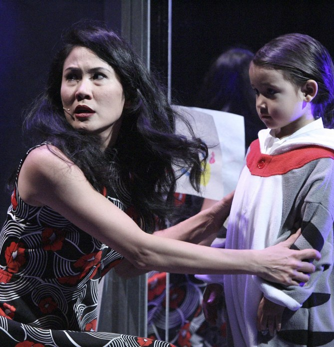 "Mrs. Walker (Deedee Magno Hall) coming to the shocking realization that her son Tommy (Araceli Prasarttongosoth) cannot see or hear in the East West Players production of ""The Who's Tommy"". Photo by Michael Lamont."