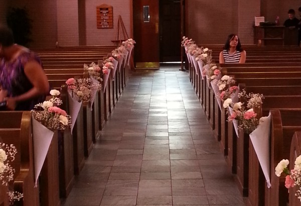 carnations hanging from the pews