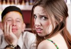 Young woman making an exasperated expression gesture on a bad date