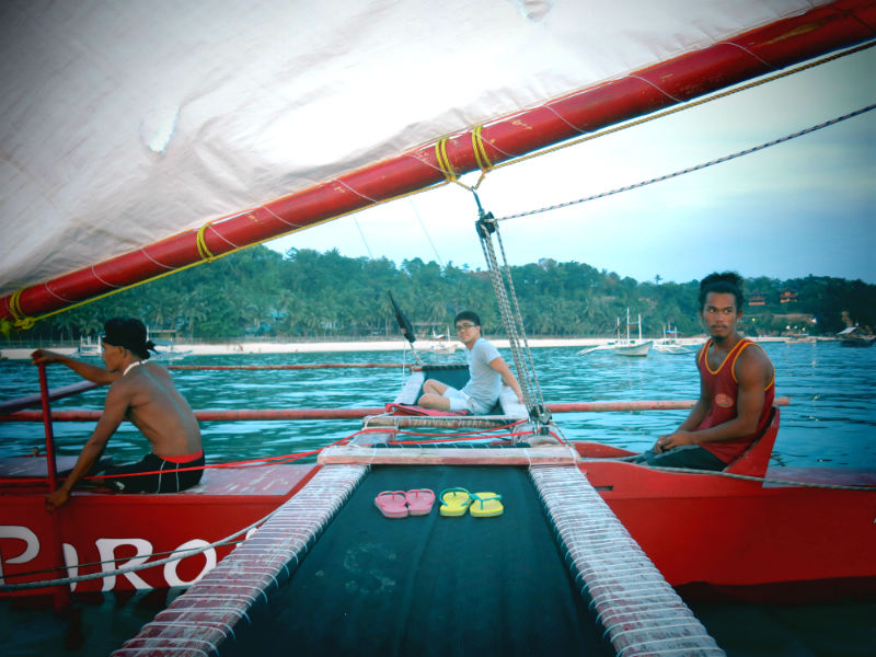 Evan Sitting on Red Pirates Paraw in the sea