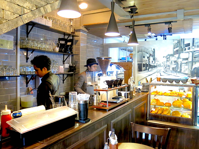 And Why Cafe Singapore Barista at Counter