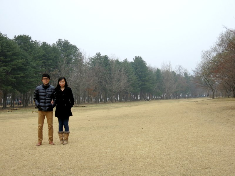 Couple at Grass Field