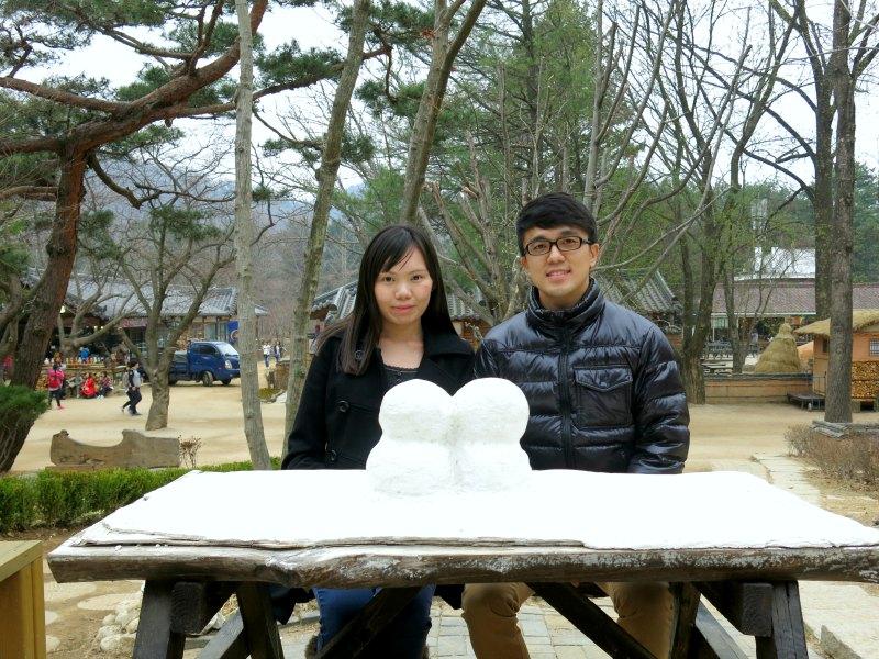 Posing with Couple Snowmen