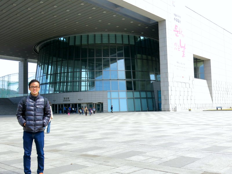 Evan posing in front of the museum
