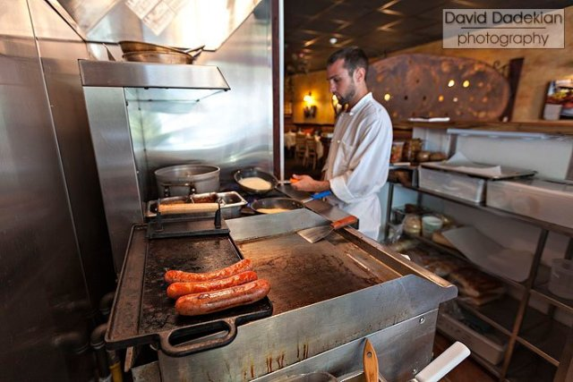 Inside the new Wurst Window kitchen, Aaron Peirolo doing prep
