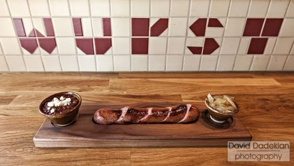 Knackwurst with Beer Onions and Feta & House Mustard. The wooden serving boards were made by Matt Gennuso's father and the small ceramic condiment bowls were made by his mother.