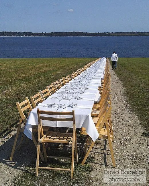 Chef Matthew Varga with the Outstanding in the Field table overlooking the Sakonnet River