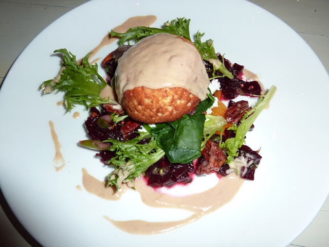 Goat cheese souffle over a salad with beets