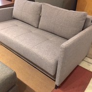 "Cubed love seat w/full XL bed & storage 62""W x 41""D Floor model $1749"