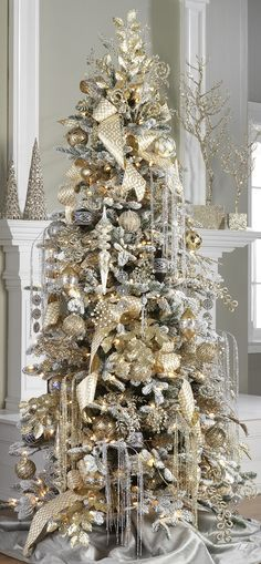 37 awesome silver and white christmas tree decorating for Silver and gold christmas tree theme
