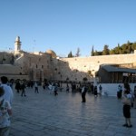 The Western Wall, Orthodox Jews here and there.