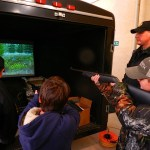 "Officers with the Department of Natural Resources assisted young hunters ""shoot"" big game such as deer and elk on their simulated hunting game."