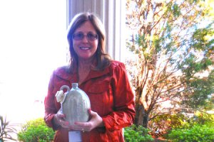 Donna Lybrand with her newly won piece of Edgefield Pottery.