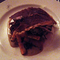 Loin of boar on a mustard mash, hidden under a large piece of crunchy air dried ham.