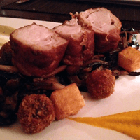Rabbit wrapped in pancetta on a generous bed of wild mushroom.