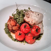 Ling with chorizo sauted potatoes, pesto and cherry tomatoes