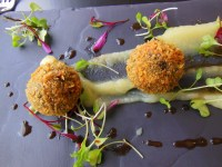 Black pudding bon bons with apple puree