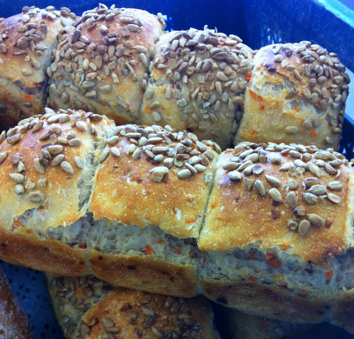 Carrot and coriander bread topped with sunflower seeds