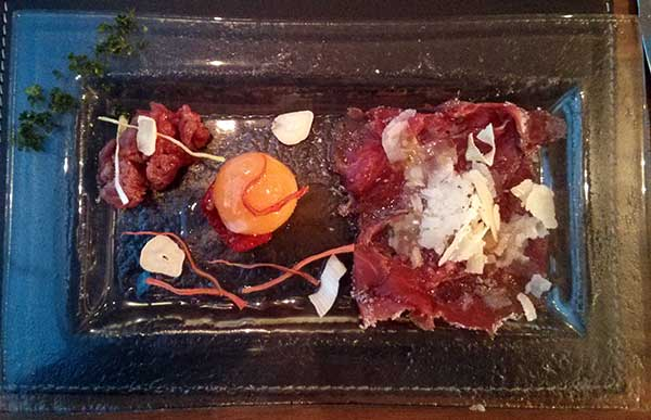 Carne cruda - delicate tartar, carpaccio supported by punchy parmesan and a perfectly cooked quail egg, all truffle scented.
