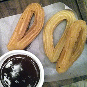 Crunchy churros and chocolate dip.