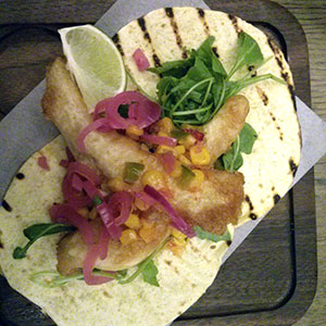 Fish tacos get an interesting bite from pickled pink onions.