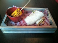Chicken fillet wrap and corn on the cob in a nice crate