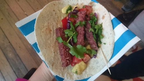 An open steak slice taco