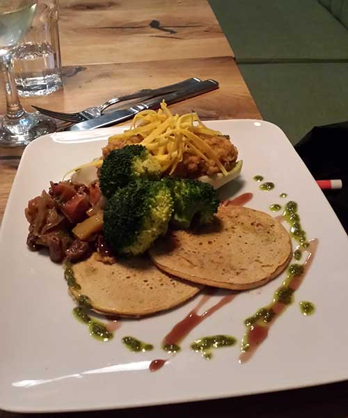 Chickpea pancakes with apricot paté and crisp veg.