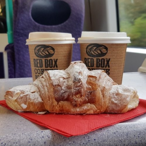 Two coffees and an almond croissant to go. Cheers.