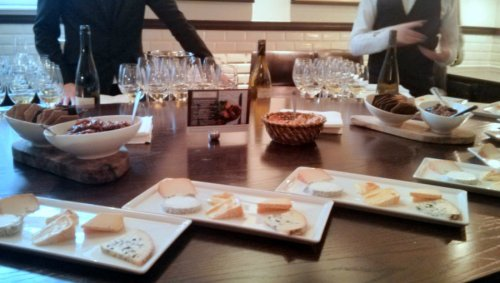 The tasting is about to start: cheese and wine waiting to be tasted.