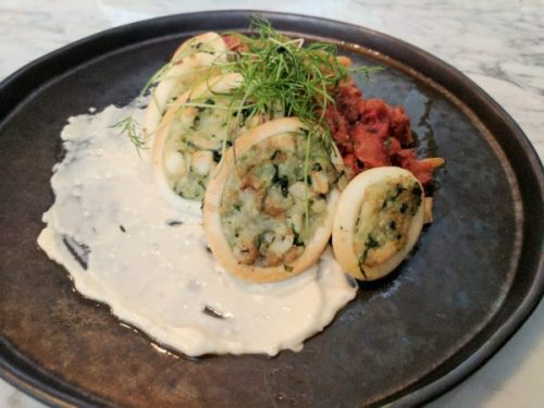 Rice and herb stuffed squid with tomato and chorizo and roast garlic mayonnaise.