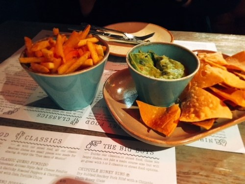 Starters - guacamole with corn tortilla chips and salt and chilli pepper fries