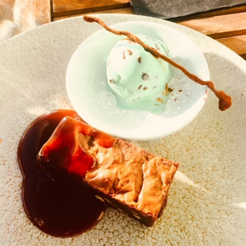 Chocolate pecan brownie, salted caramel sauce and mint chocolate chip ice-cream on the side