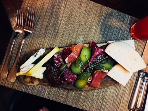 The charcuterie & cheese board is a generous portion for one person