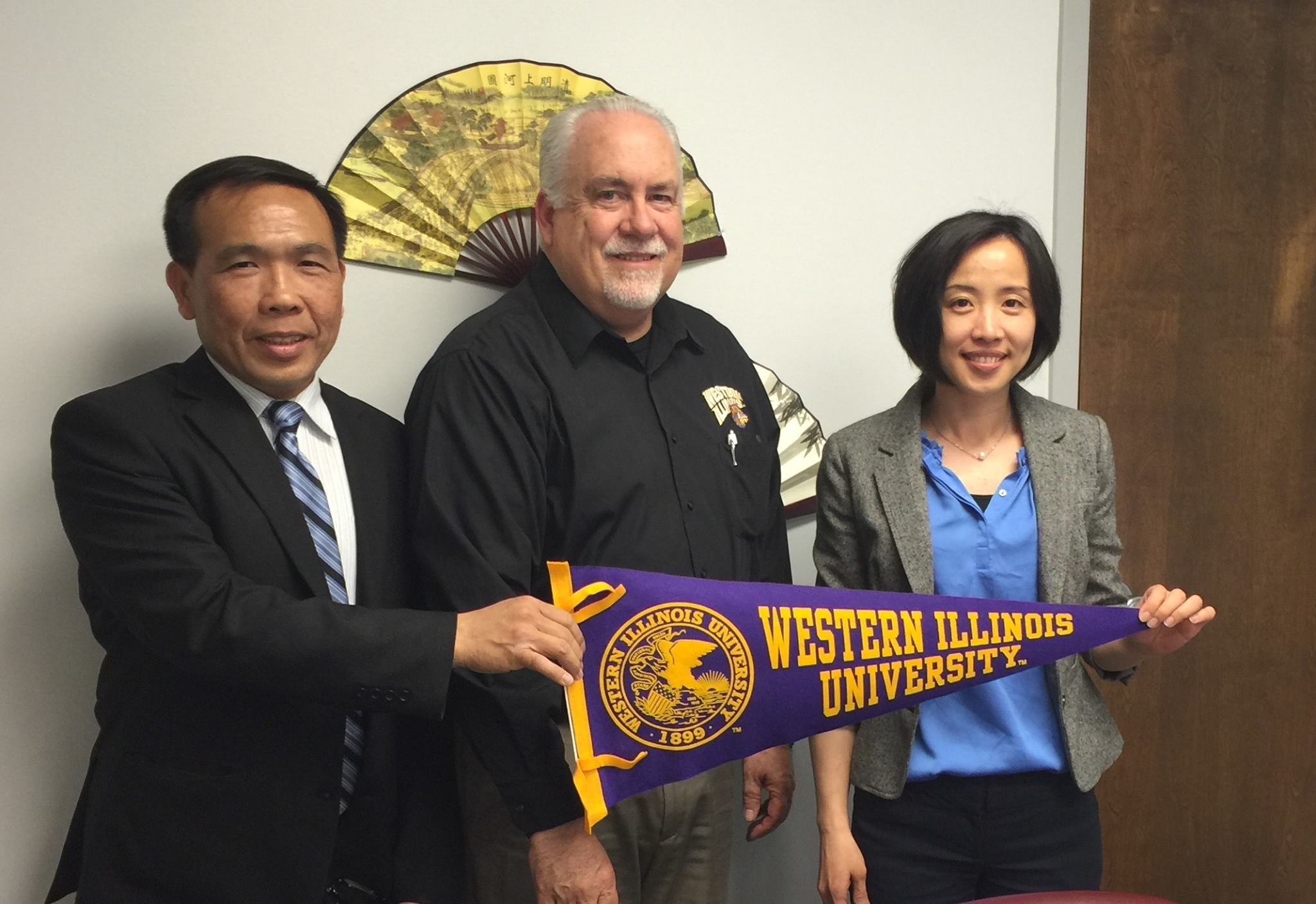 Visit Director Richard Carter of WIU international studies (middle) with Deputy Director Erica Lee