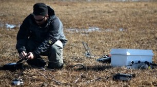 Elliot Friedman installing subsurface bioelectrochemical systems to measure microbial activity in a drained thaw lake basin outside Barrow, AK. Photo By: Jim Miller