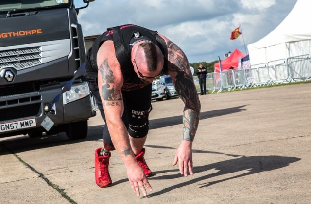 Leigh Bland pulling truck in strongman competition