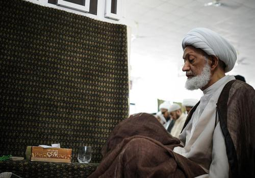 Bahraini top senior shiite cleric, Sheikh Isa Qassim (R) takes part in the Friday prayer at a mosque in the village of Diraz, west of the capital Manama, on May 17, 2013. Bahraini Police raided overnight the home of Sheikh Qassim, who strongly supports the anti-government protestors, Wefaq National Islamic Society said.   AFP PHOTO/MOHAMMED AL-SHAIKH        (Photo credit should read MOHAMMED AL-SHAIKH/AFP/Getty Images)