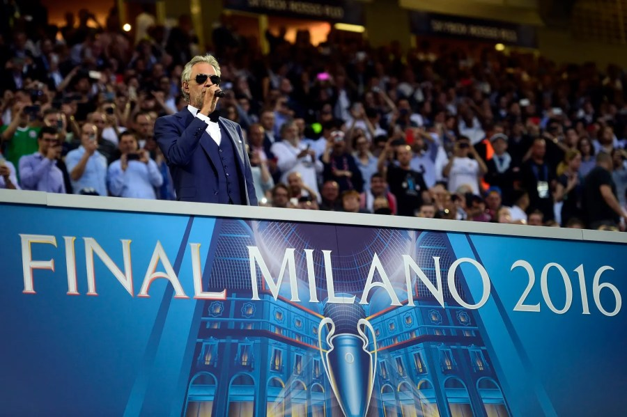 Italian opera singer Andrea Bocelli performs at the start of the UEFA Champions League final football match between Real Madrid and Atletico Madrid at San Siro Stadium in Milan, on May 28, 2016. / AFP PHOTO / PIERRE-PHILIPPE MARCOU