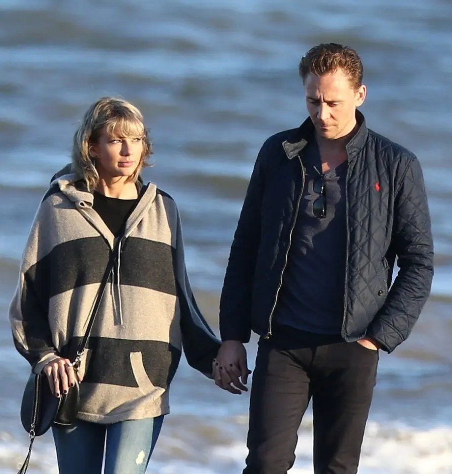 Picture Shows: Taylor Swift, Tom Hiddleston June 25, 2016 Taylor Swift and boyfriend Tom Hiddleston go for a romantic walk along the beach in the UK. The pair were joined by Tom's mum Diana Hiddleston for the stroll in the evening sunlight. The couple were on a whirlwind tour to visit the family in the UK. Exclusive WORLDWIDE RIGHTS Pictures by : FameFlynet UK ¿ 2016 Tel : +44 (0)20 3551 5049 Email : info@fameflynet.uk.com