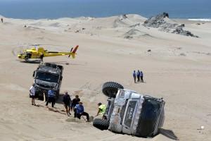 Dakar Rally staff work around a support truck that turned along the beach during the third stage of the 2018 Dakar Rally between Pisco and San Juan de Marcona, Peru, Monday, Jan. 8, 2018. (AP Photo/Ricardo Mazalan)